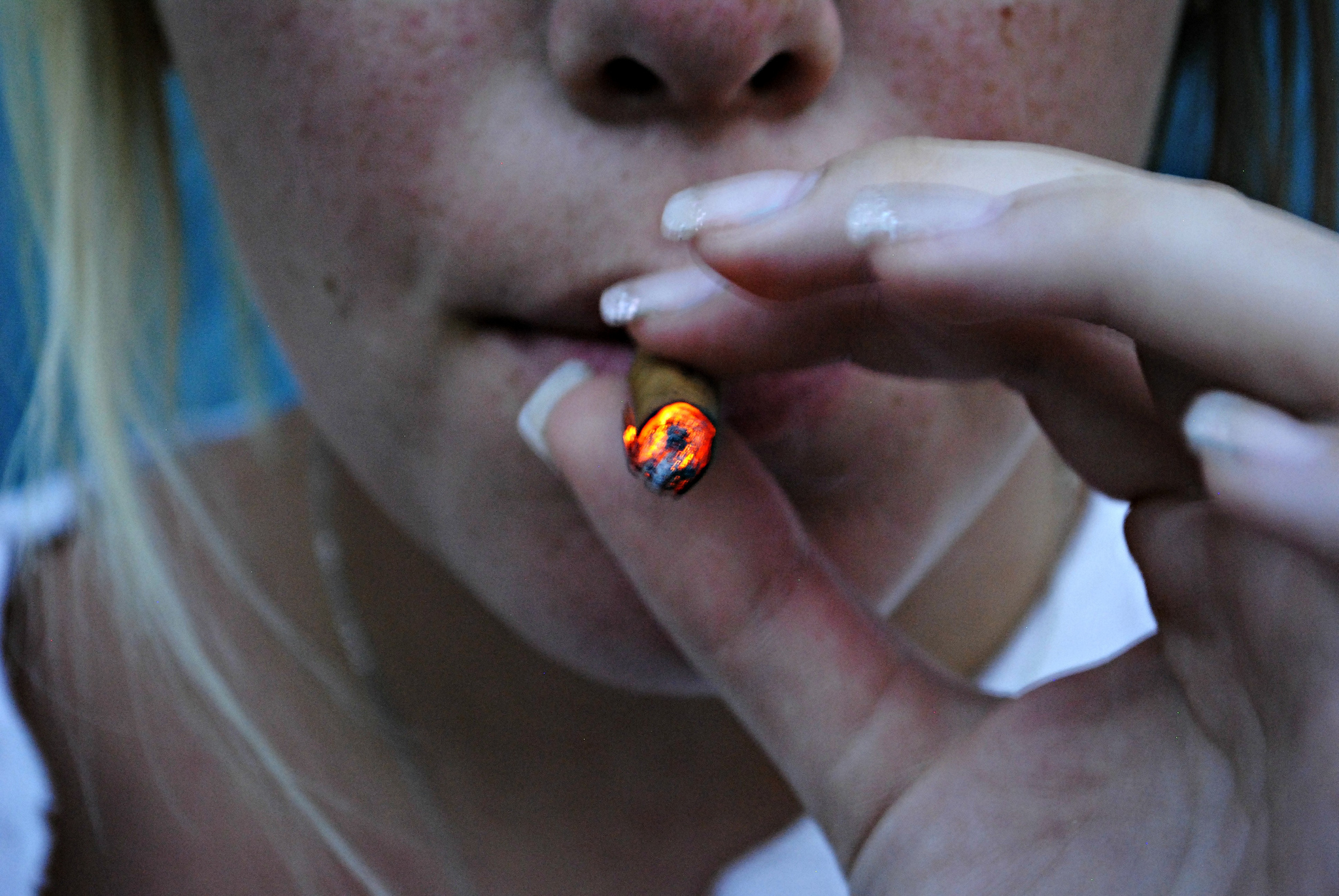 Girl smoking weed blunt