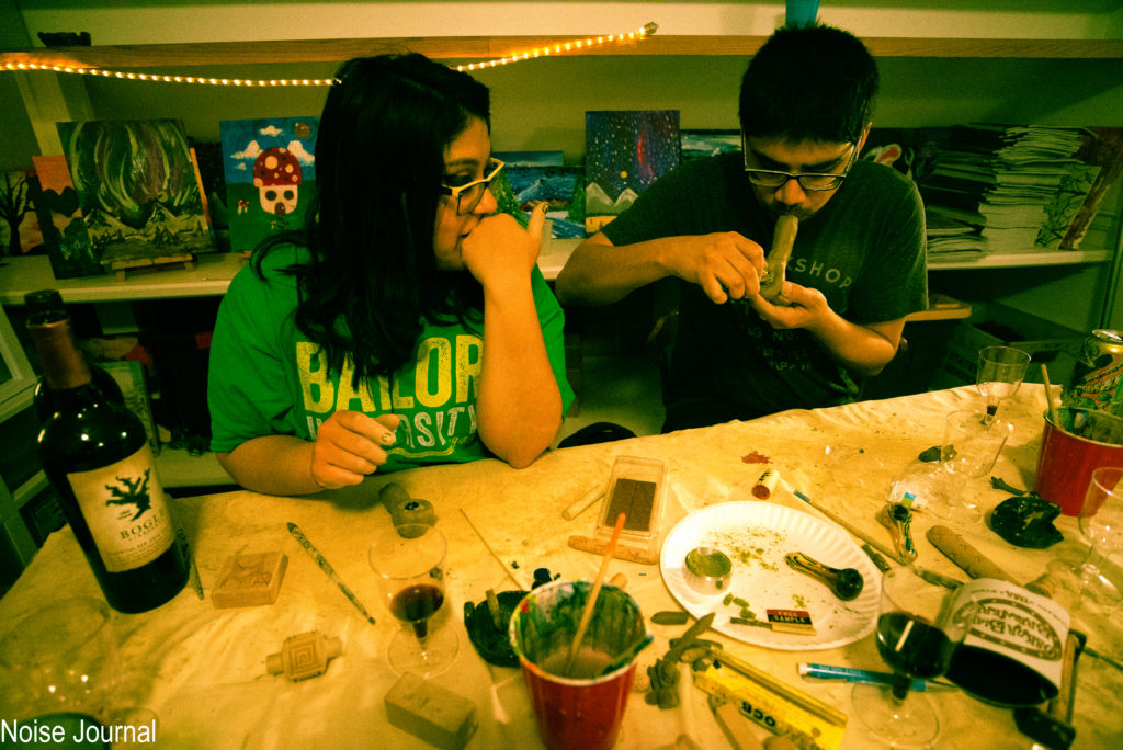 Participants at Denver's Puff, Pass and Pottery class try out their new accessory on Friday, April 14, 2017. Perhaps surprisingly, smoking accessories were one of the least-made items at the cannabis themed event. By Jonathan Rose